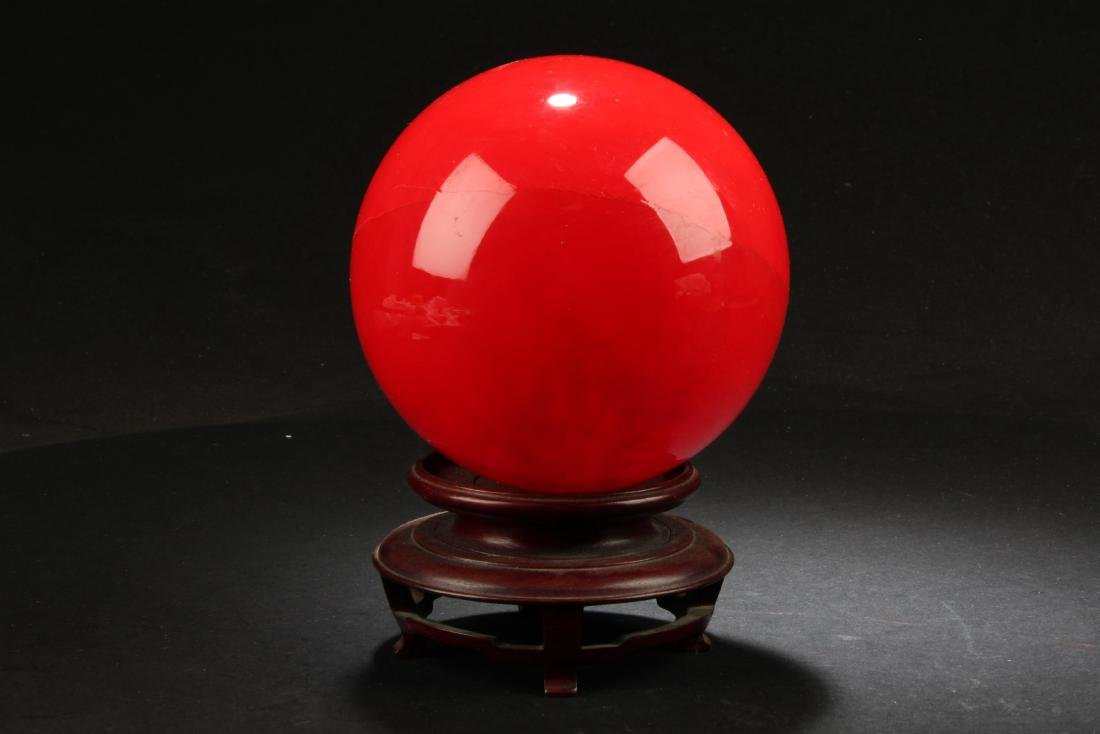 A Chinese Red Ball Ornament