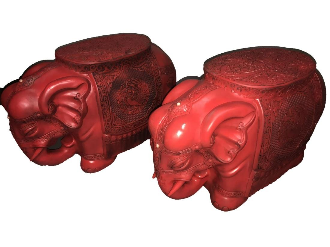 A Pair of Chinese Red Elephant Stools