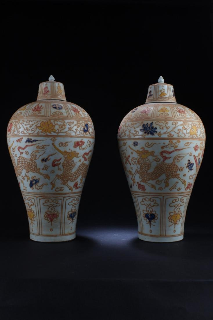 A Pair of Chinese Porcelain Vases with Lid Covers
