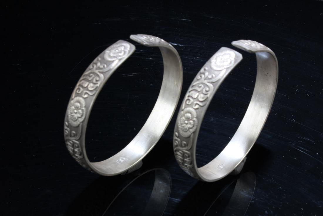 A Pair of Chinese Carved Bangles