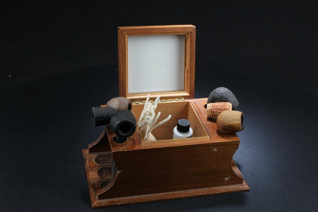 A Smoking Pipe Holder with Six Smoking Pipes