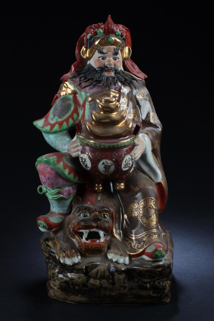 Chinese Porcelain Deity Statue