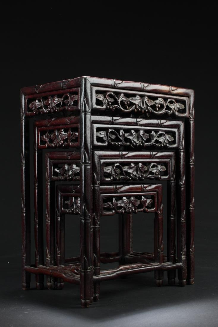 A Set of Four Chinese Rosewood Stool Set