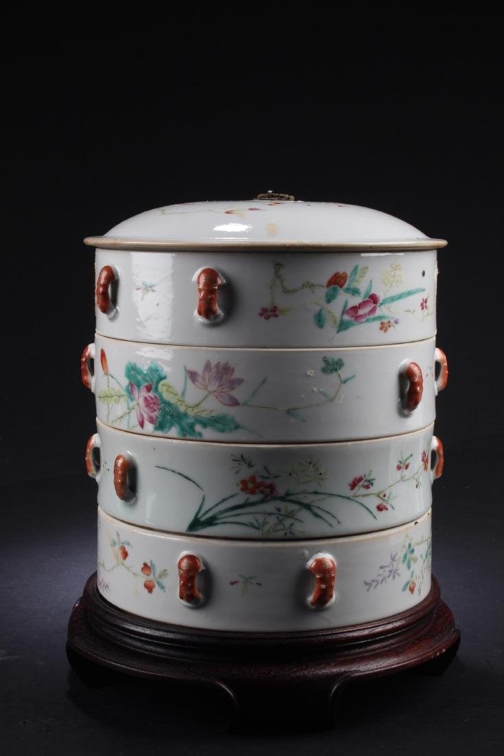 A Chinese Four Tier Porcelain Fencai Round Container