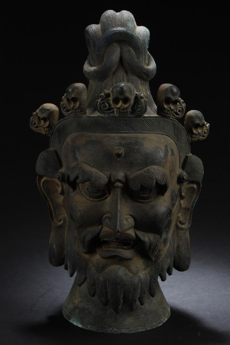 A Chinese Bronze Deity Head Statue