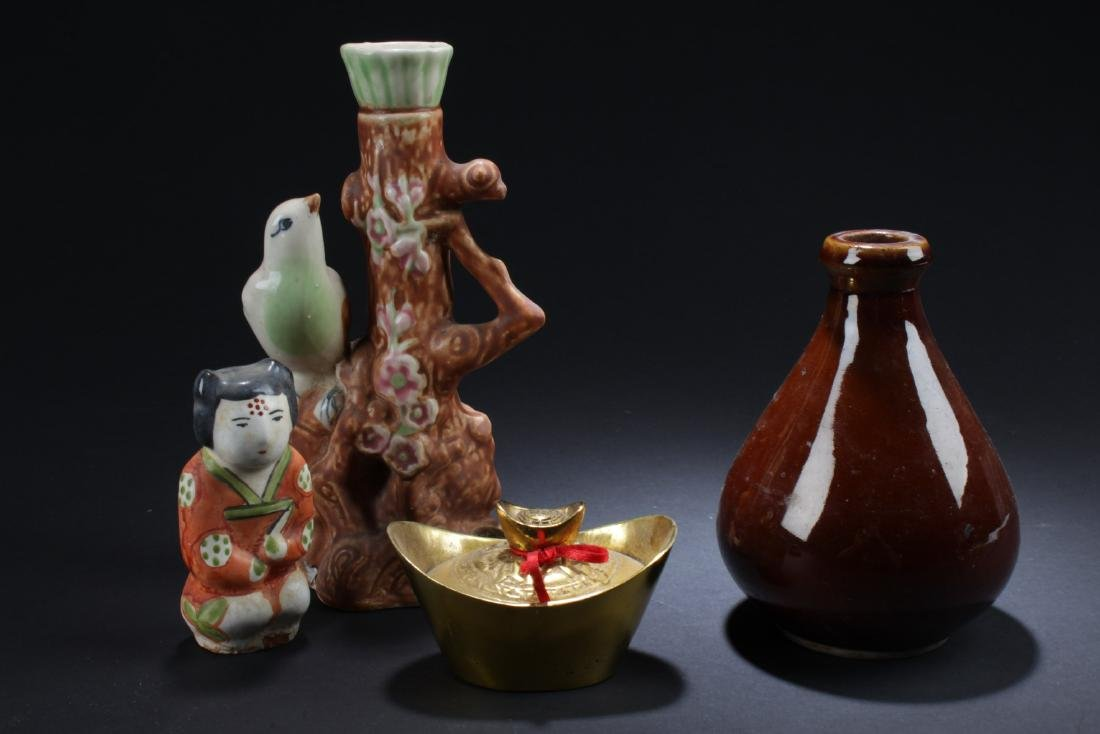 A Group of Four Porcelain Ornaments