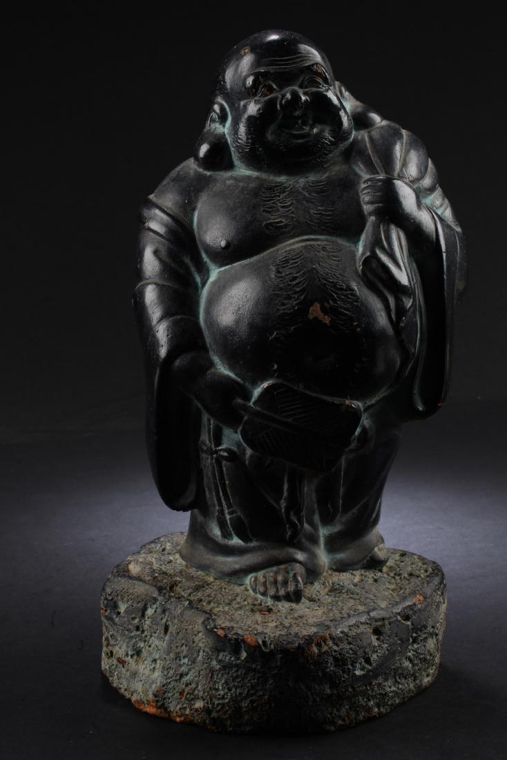 A Chinese Smiling Buddha Statue