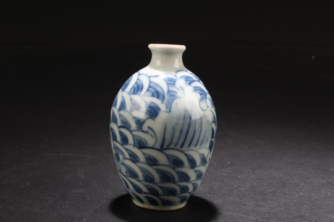 A Chinese Porcelain Snuff Bottle. Height: 3""
