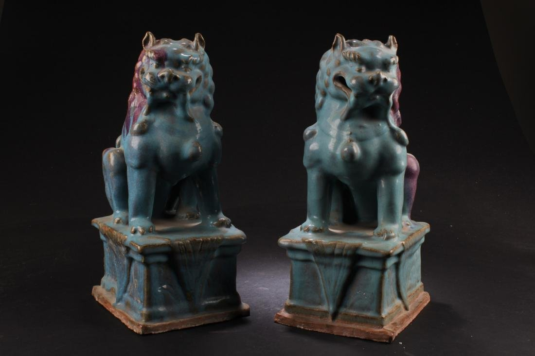 A Pair of Junyao Porcelain Foo Dog Displays