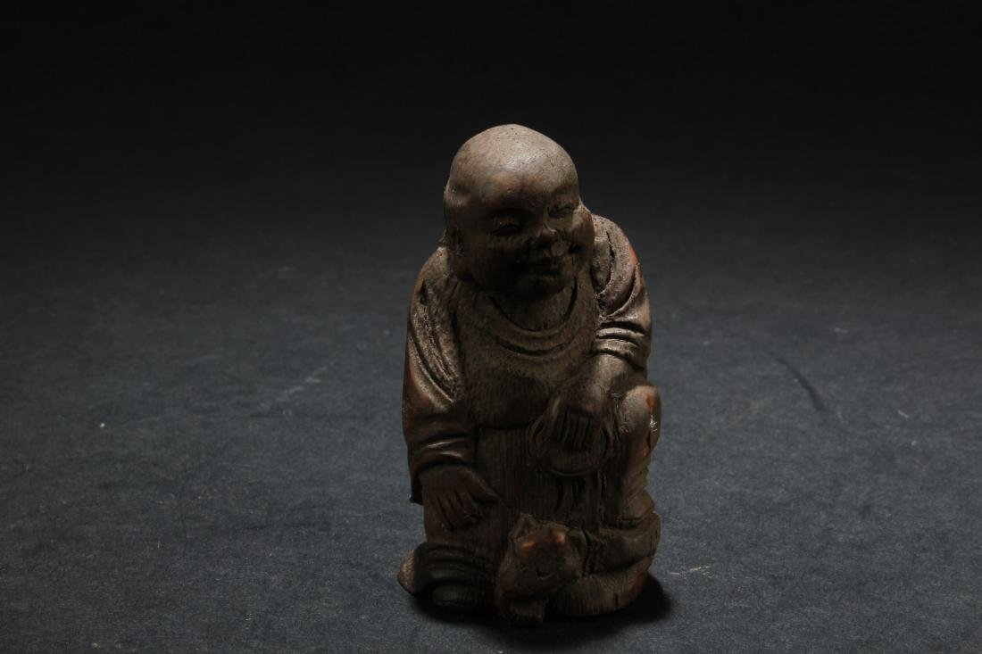 A Wooden Carved Monk Statue