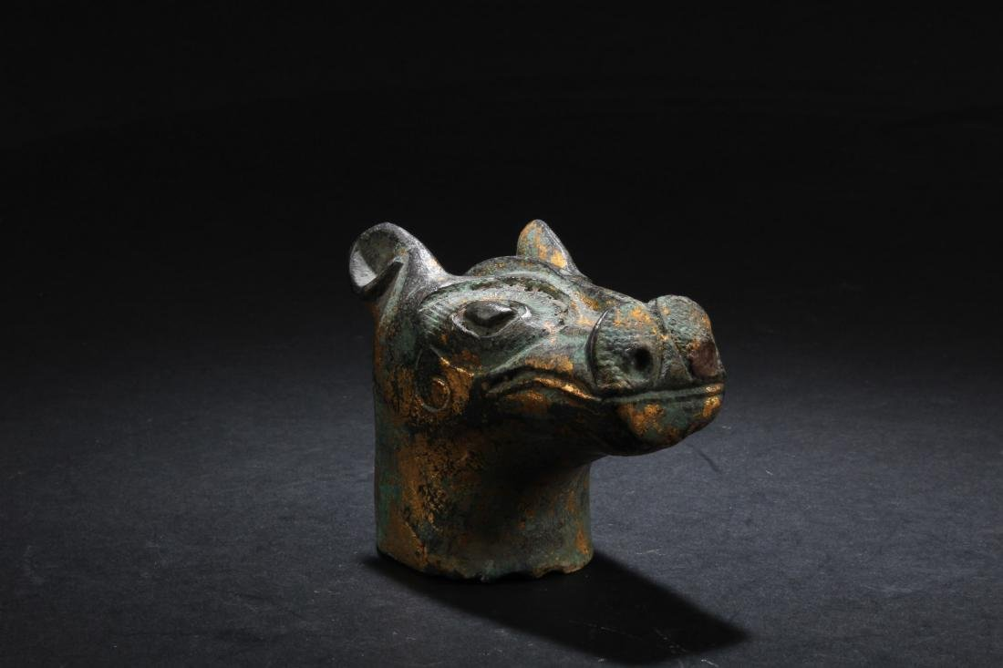A Bronze Animal Head Statue