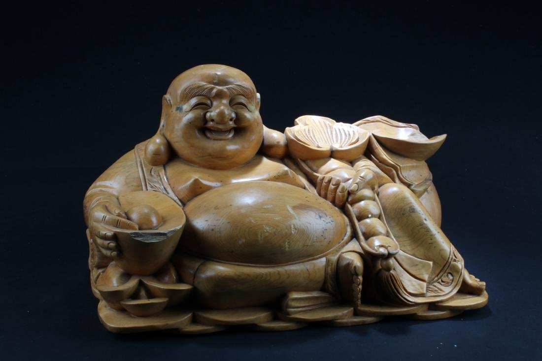 A Chinese Wooden Carved Smiling Buddha Statue
