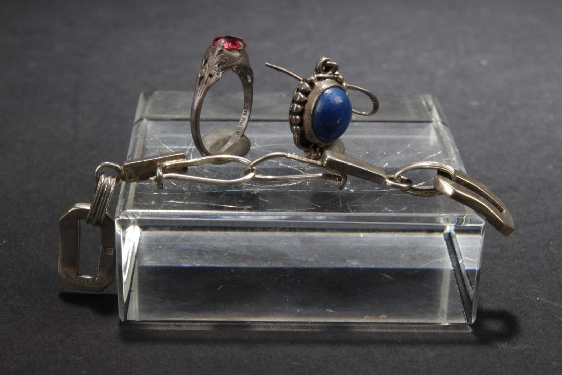 Three Earrings and a Ring