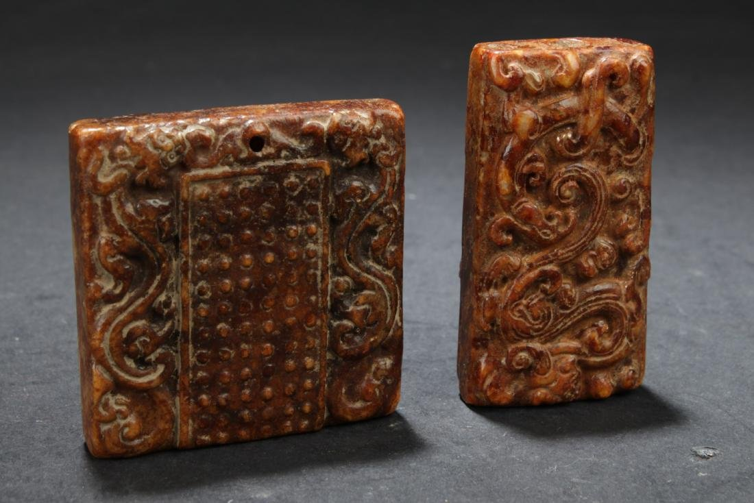 A Group of Two Chinese Jade Pendants