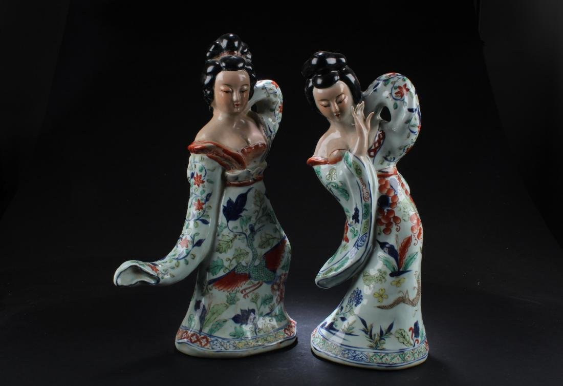A Pair of Chinese Porcelain Maiden Statues