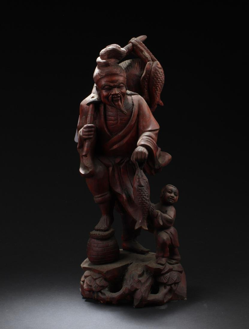 A Chinese Wooden Carved Statue