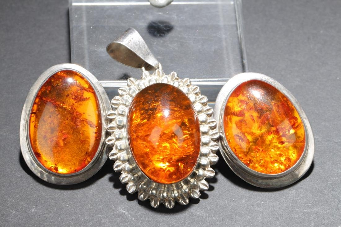 A Pair of Antique Amber Earrings and one Amber Pendant