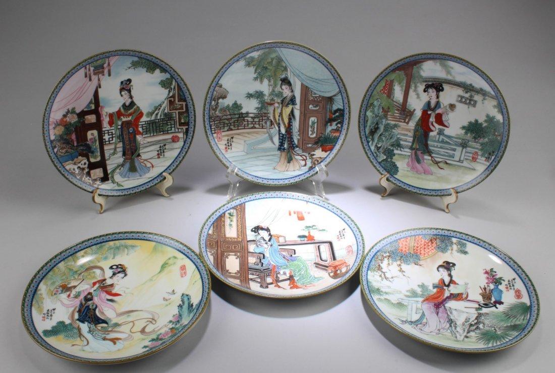 A Set of Six Round Decorative Plates