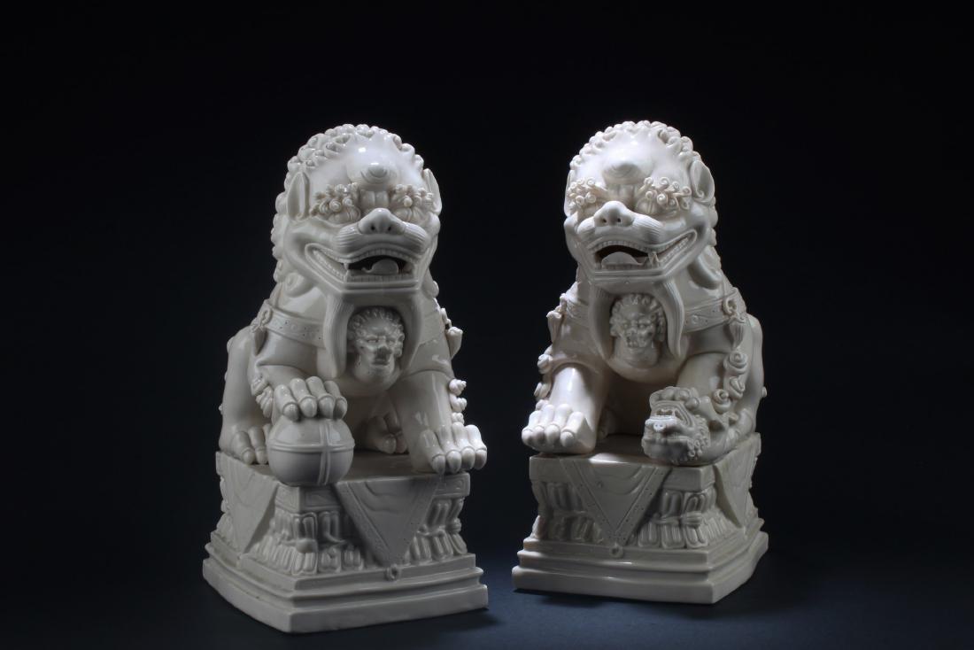 A Pair of Blanc De Chine Foo Dog Display