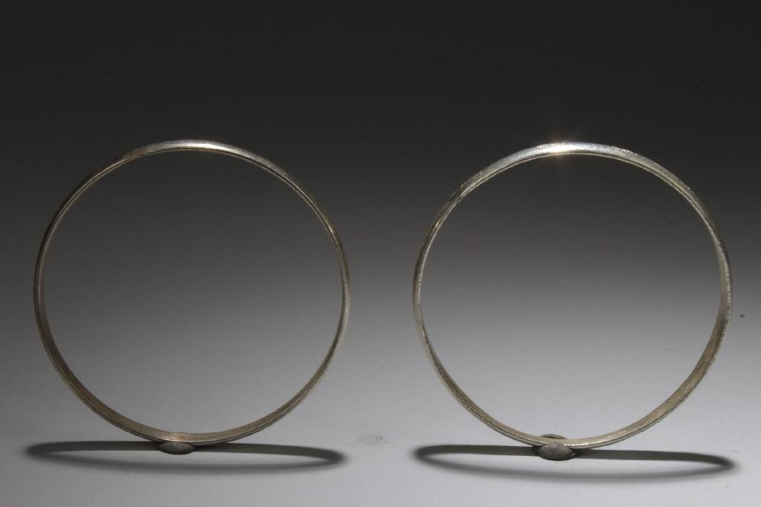 A Pair of Silver Bracelets