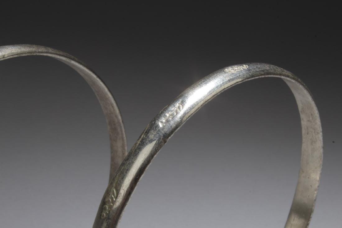 A Pair of Silver Bracelets - 4
