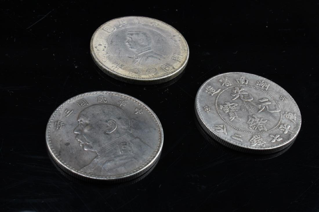 A Group Of Three Chinese Coins