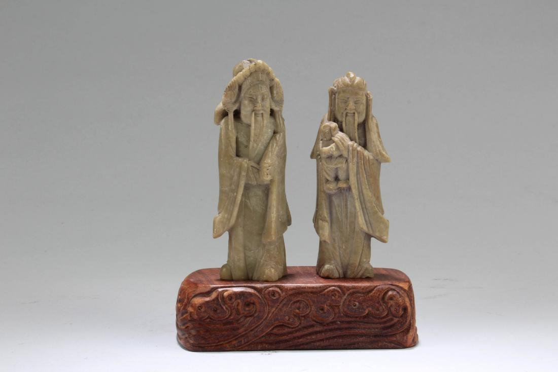 A Pair of Carved Figurines