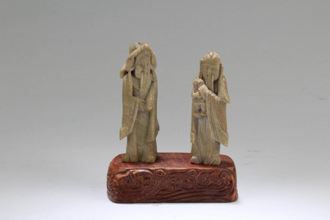 A Pair of Carved Figurines - 2