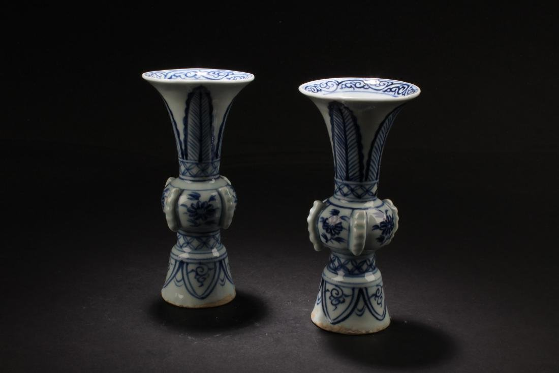 A Pair of Chinese Blue & White Porcelain Candle Holders