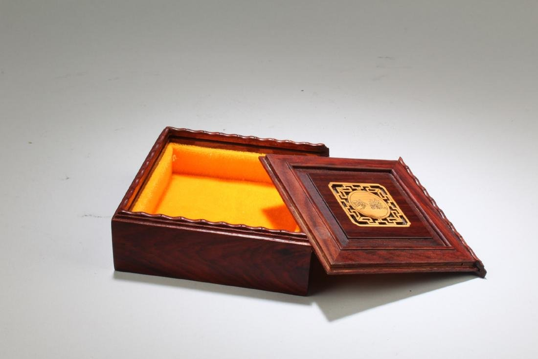 A Wooden Square Box