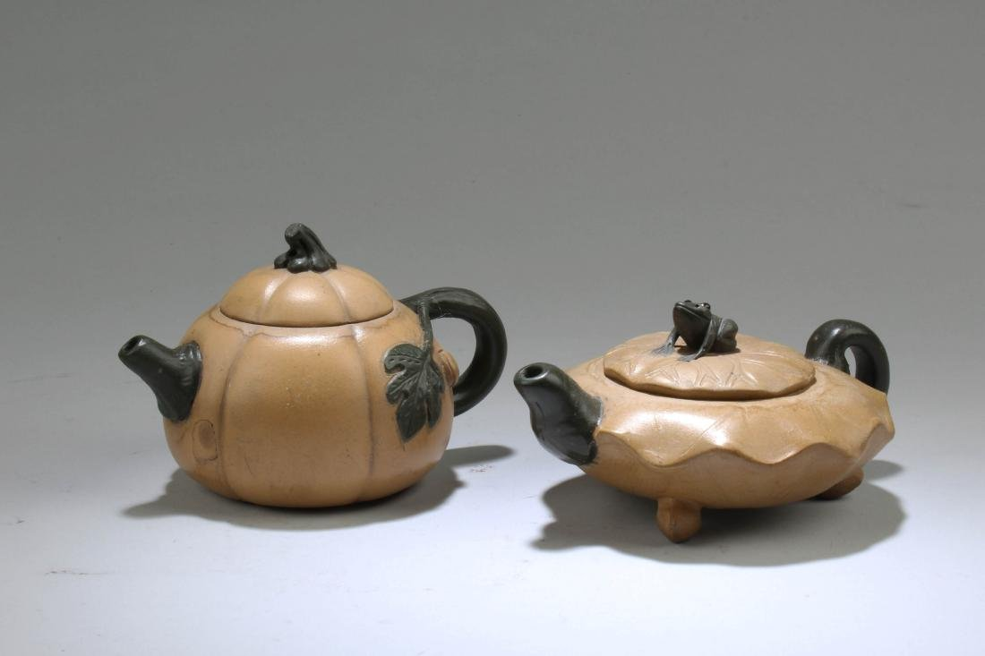 A Group of Two Chinese Zisha Teapot