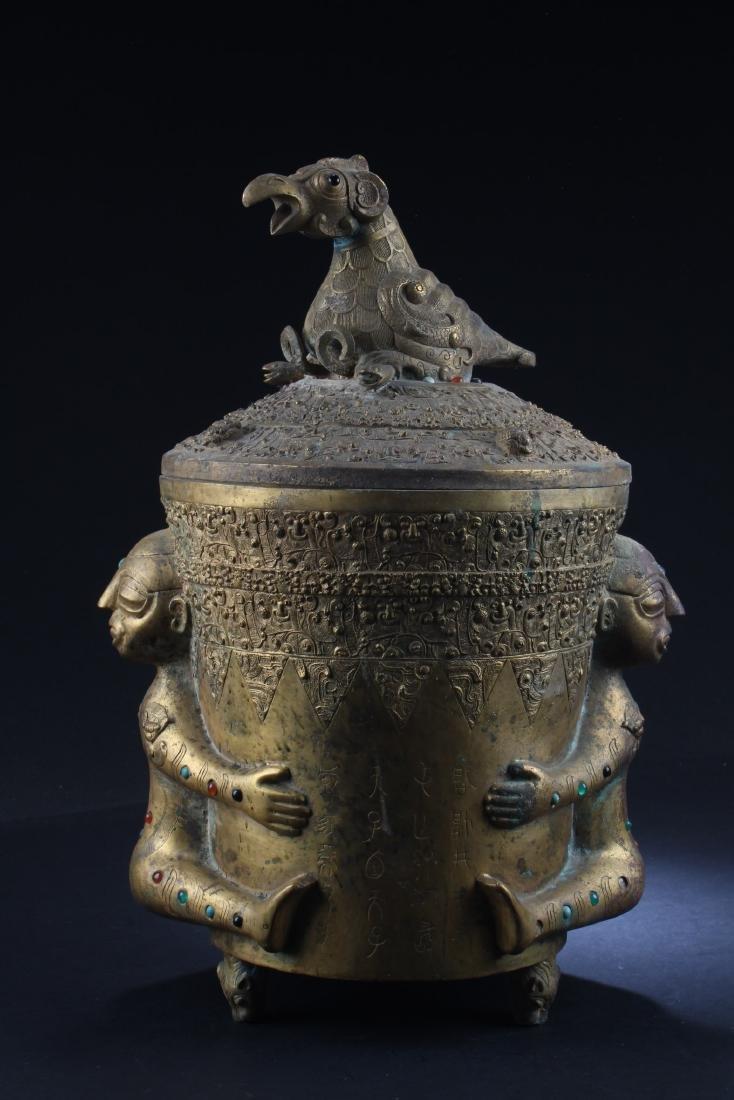 A Gilt Bronze Round Tripod Container