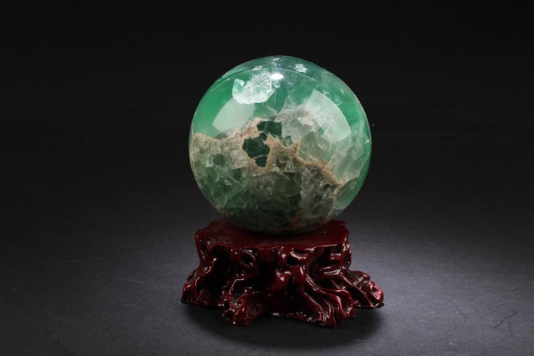 A Quartz Ball with Wooden Stand - 2
