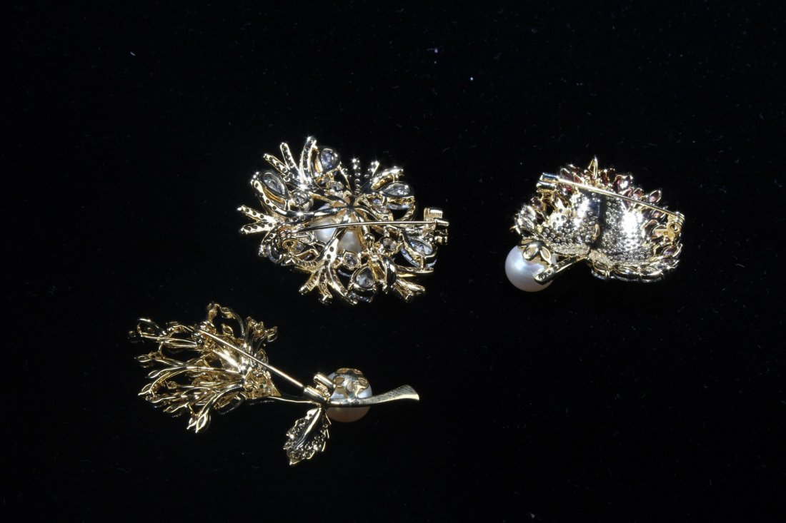 A Group of Three Natural Pearl with Manmade crystal - 10