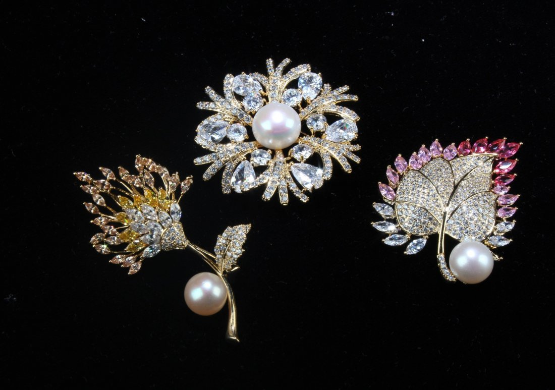 A Group of Three Natural Pearl with Manmade crystal
