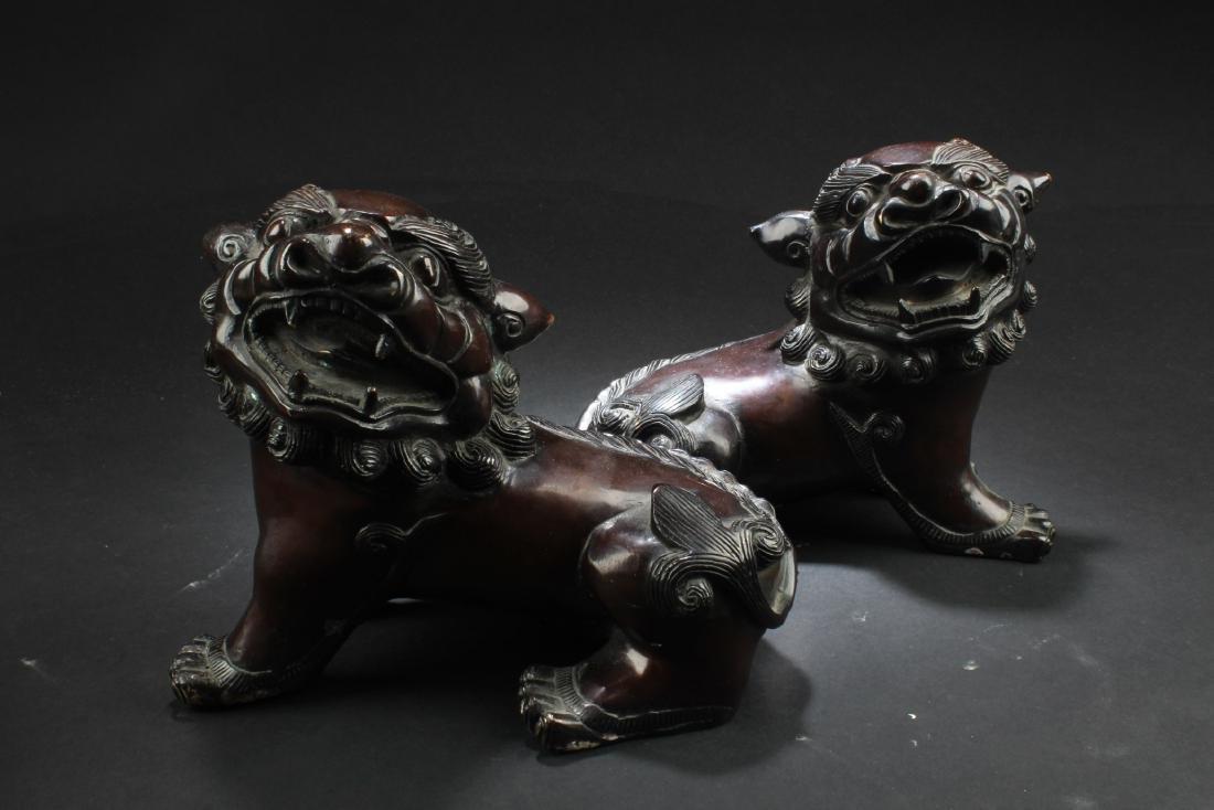 A pair of Chinese Bronze Foo Dog Display - 2