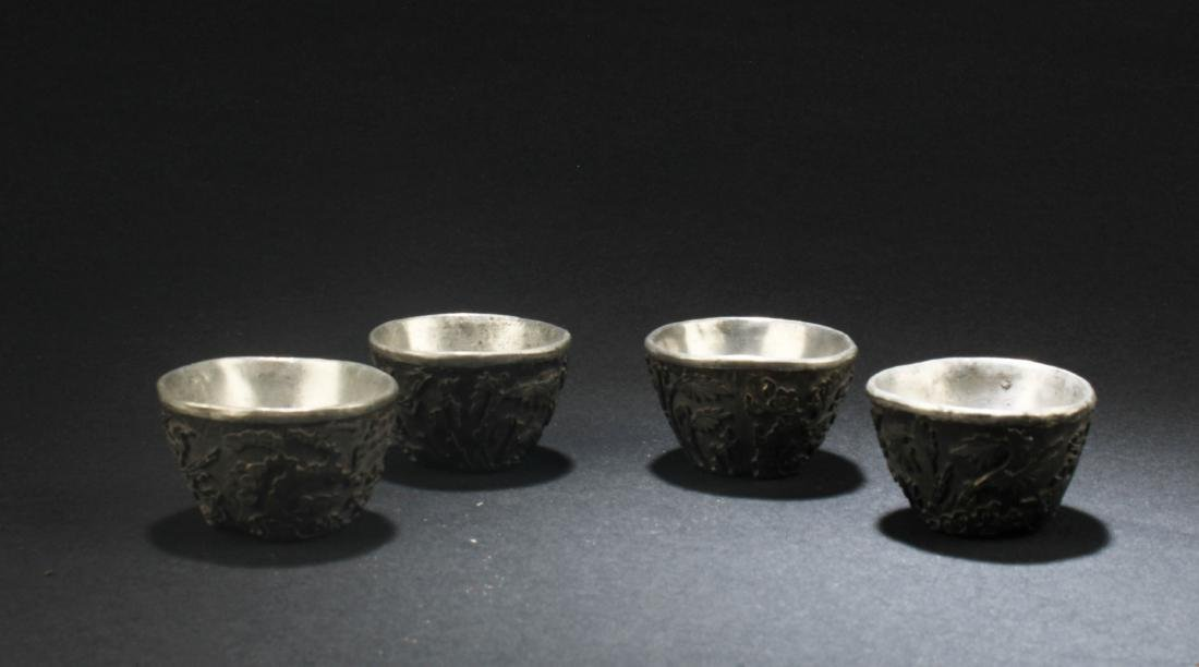 A Group of Four Chinese Antique Silver Cups