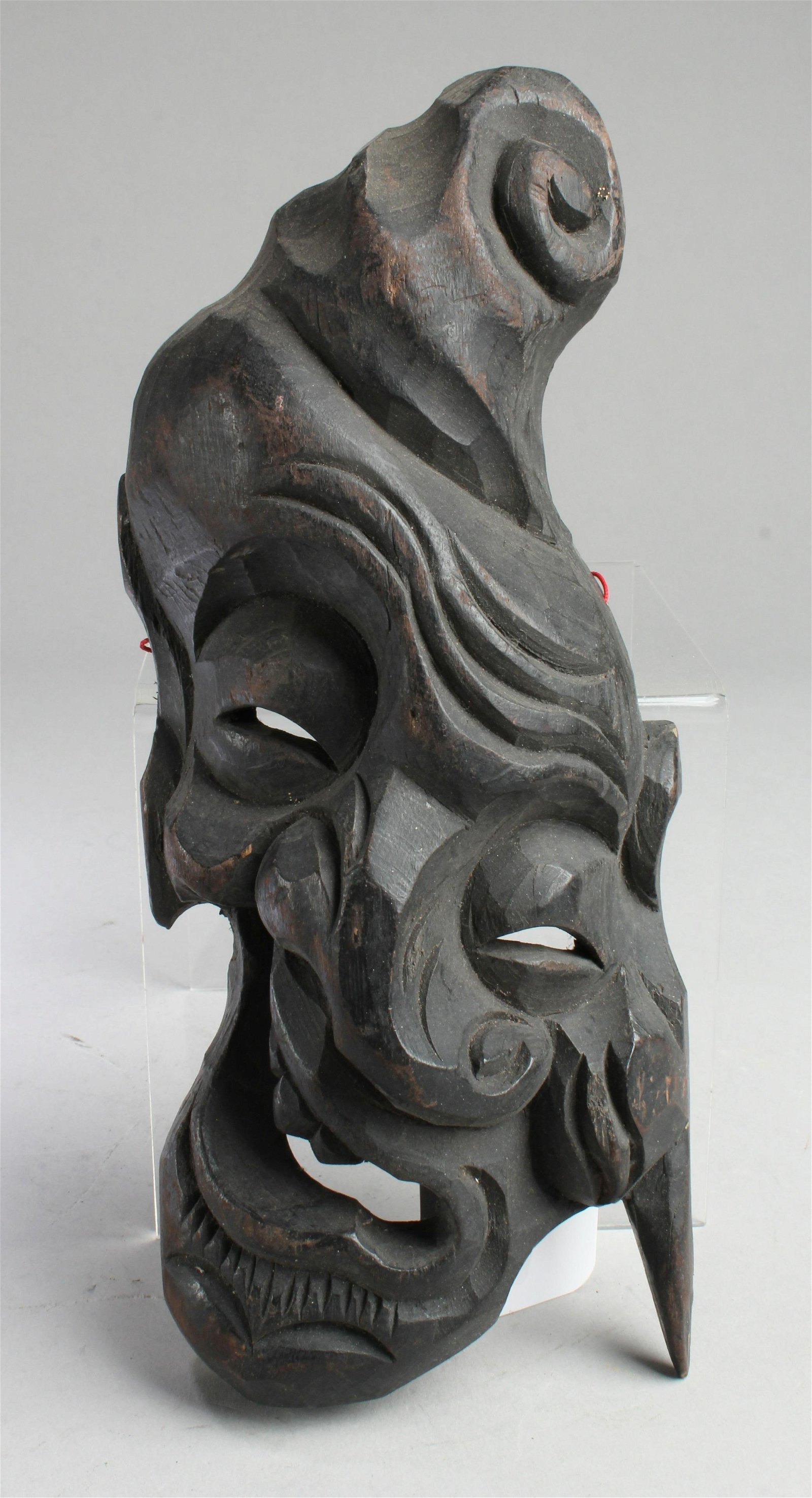 A Carved Wooden Face Ornament