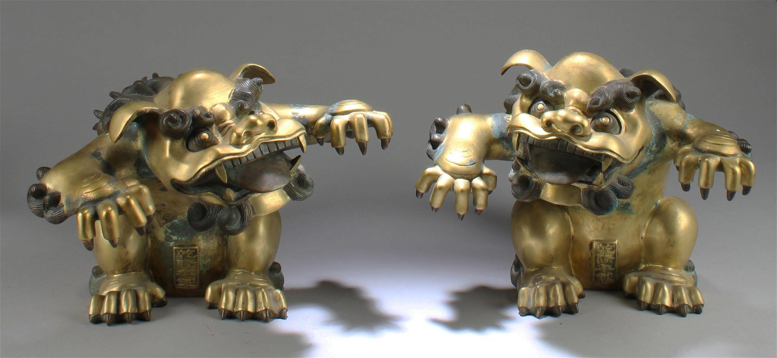 A Pair of Antique  Gilt Bronze Mythical Beast Statues