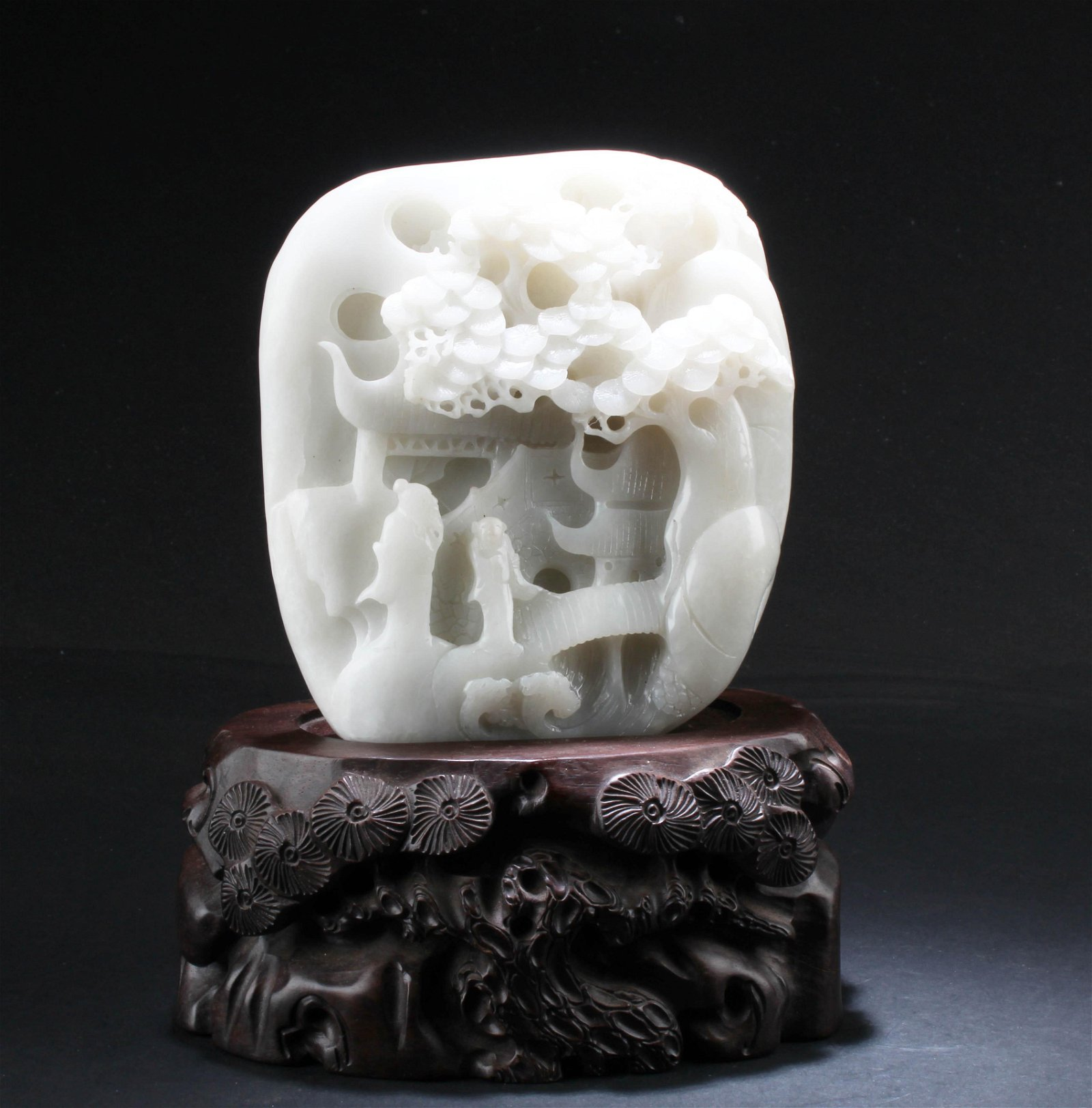 A Chinese White Jade Carving with Wooden Stand