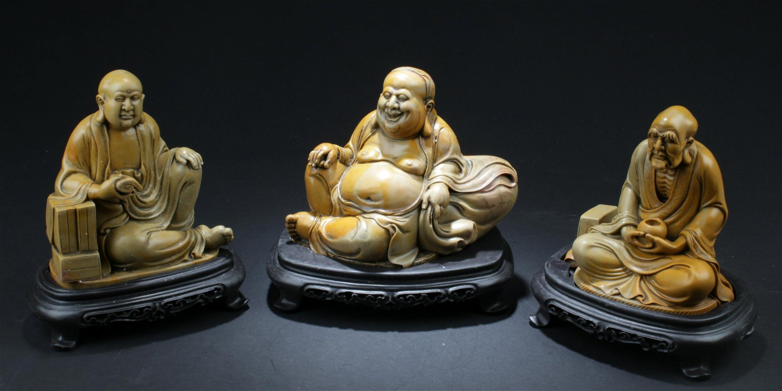 A Group of Three Soapstone Carved Statues
