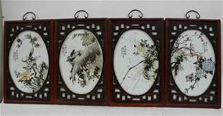 A Group of Four Chinese Hardwood Framed Porcelain Plaqu
