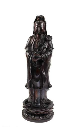 A Carved Hardwood (Possibly Zitan) Guanyin Statue