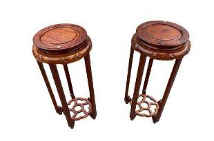 A Pair of Chinese Hardwood Round Flower Stands