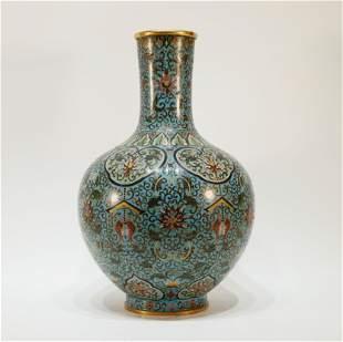 A cloisonne gilt bronze flora fish pattern bottle