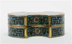 A cloisonne bronze gilt flora pattern box