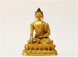 A fine Tibetan gilt bronze  Figure of Buddha