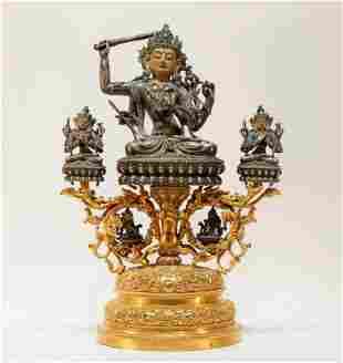A silver gilt-bronze Tibetan statue of Manjusri