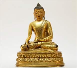 A superb Tibetan gilt bronze Sakyamuni statue