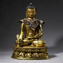 A gilt Bronze Statue of Medicine Buddha